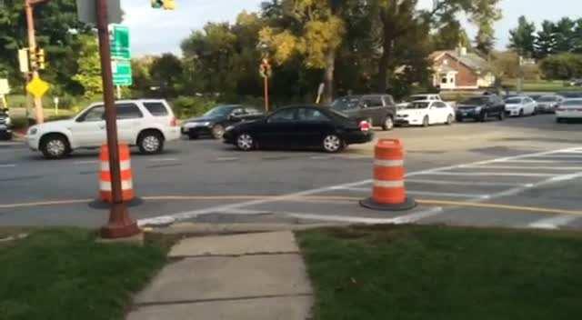 Cars blocking intersection of Boston & Cummings